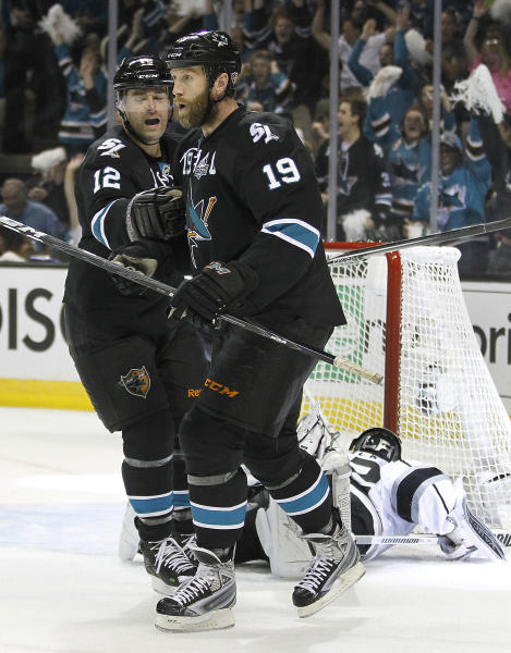 San Jose Sharks center Joe Thornton (19) celebrates with teammate San Jose Sharks center Patrick Marleau (12) after scoring a goal against Los Angeles Kings during the first period in Game 6 of their second-round NHL hockey Stanley Cup playoff series in San Jose, Calif., Sunday, May 26, 2013. (AP Photo/Tony Avelar)