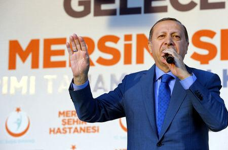 Turkish President Tayyip Erdogan addresses his supporters during an opening ceremony in Mersin