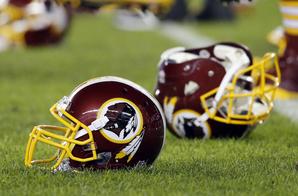 In this Dec. 26, 2015, file photo, a Washington Redskins helmet sits on the field as players warm up before an NFL football game against the Philadelphia Eagles in Philadelphia. AP Photo/Matt Rourke