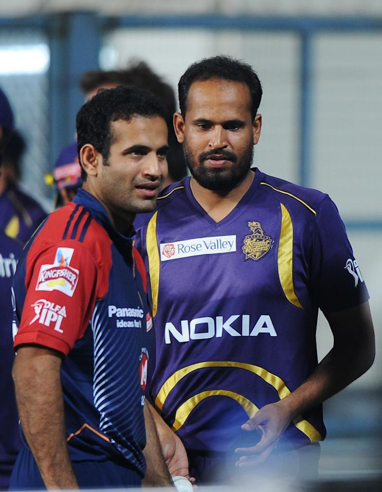 Kolkata Knight Riders batsman Yusuf Pathan (R) shares a light a moment with Delhi Daredevils player and his brother Irfan Pathan as the IPL Twenty20 cricket match between Kolkata Knight Riders and Delhi Daredevils is delayed due to rain at The Eden Gardens Cricket Stadium in Kolkata on April 5, 2012.  RESTRICTED TO EDITORIAL USE. MOBILE USE WITHIN NEWS PACKAGE.  AFP PHOTO/Dibyangshu SARKAR (Photo credit should read DIBYANGSHU SARKAR/AFP/Getty Images)