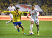 Sweden's Kristoffer Olsson, left, and Spain's Thiago Alcantara fight for the ball during their Euro 2020 Group F qualification soccer match between Sweden and Spain at Friends Arena in Solna, Stockholm, Sweden, on Tuesday Oct. 15, 2019.(Anders Wiklund / TT via AP)