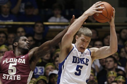 Florida State's Bernard James (5) and Duke's Mason Plumlee, right, struggle for a rebound during the first half of an NCAA college basketball game in Durham, N.C., Saturday, Jan. 21, 2012. (AP Photo/Gerry Broome)