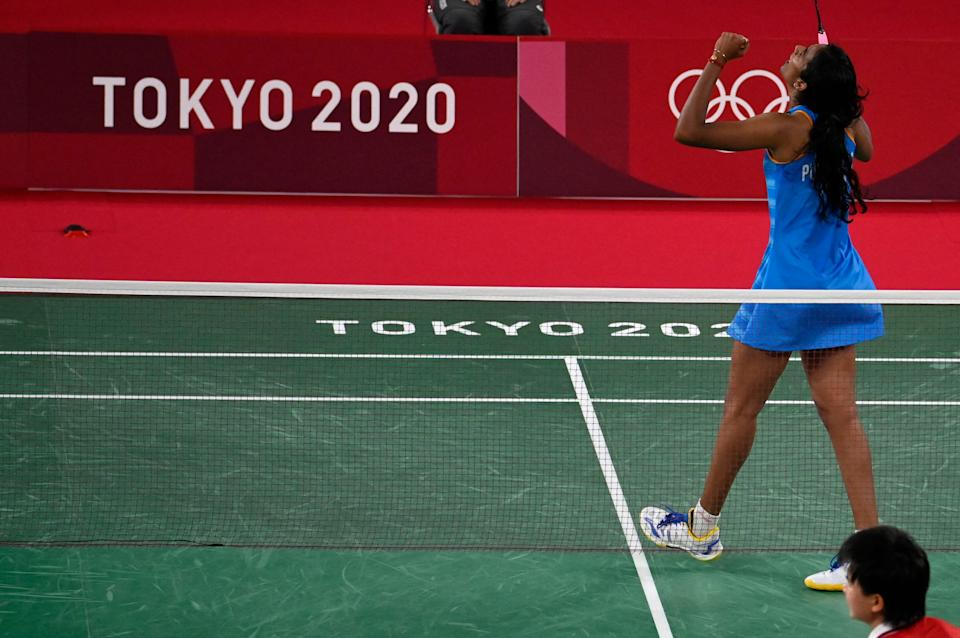 India's P. V. Sindhu celebrates after beating China's He Bingjiao in their women's singles badminton bronze medal match during the Tokyo 2020 Olympic Games at the Musashino Forest Sports Plaza in Tokyo on August 1, 2021. (Photo by Alexander NEMENOV / AFP) (Photo by ALEXANDER NEMENOV/AFP via Getty Images)