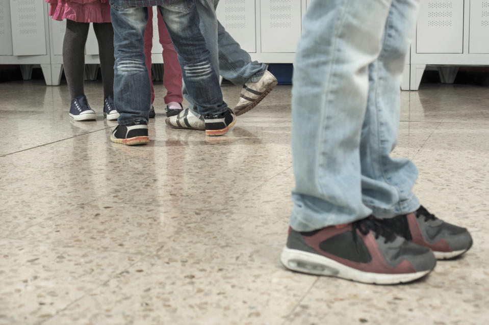 A boy was shoved into the hallway and kicked by his teacher while he was on the ground at school. (Photo: Getty Images)