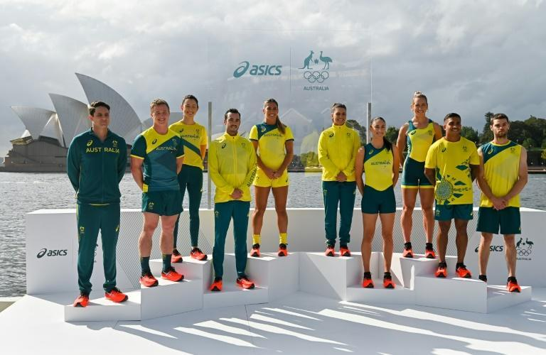 Australian athletes unveil the ASICS-branded Australian Olympic Team competition uniforms for the Tokyo Games in front of the Sydney Opera House