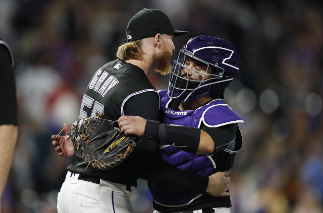 Colorado Rockies starting pitcher Jon Gray, left, hugs catcher Tony Wolters after a baseball game against the Los Angeles Dodgers, Monday, July 29, 2019, in Denver. The Rockies won 9-1. (AP Photo/David Zalubowski)