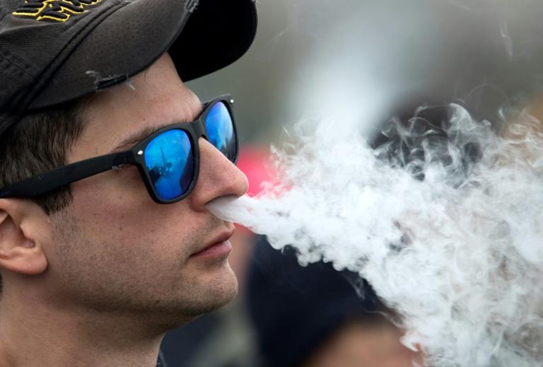 The Senate passed a bill that will go into effect in 2020 and adds tobacco and e-cigarettes to the list of substances that are prohibited to purchse for those under the age of 21 (AFP Photo/Jose Luis Magana)