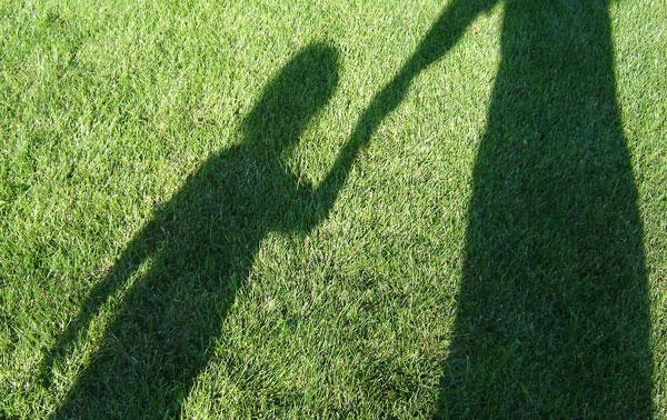 Being A Mother Is Easy, It's Everything Else That's A Challenge: Child and mother shadow in grass