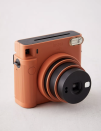 """<p><strong>Fujifilm</strong></p><p>urbanoutfitters.com</p><p><strong>$120.00</strong></p><p><a href=""""https://go.redirectingat.com?id=74968X1596630&url=https%3A%2F%2Fwww.urbanoutfitters.com%2Fshop%2Ffujifilm-sq1-instax-square-camera%3Fcolor%3D010%26type%3DREGULAR%26size%3DONE%2BSIZE%26quantity%3D1&sref=https%3A%2F%2Fwww.housebeautiful.com%2Fshopping%2Fg37757608%2Fgifts-for-boyfriends%2F"""" rel=""""nofollow noopener"""" target=""""_blank"""" data-ylk=""""slk:Shop Now"""" class=""""link rapid-noclick-resp"""">Shop Now</a></p><p>This beautiful matte camera will capture your adventures with one click. It also comes with a selfie setting!</p>"""