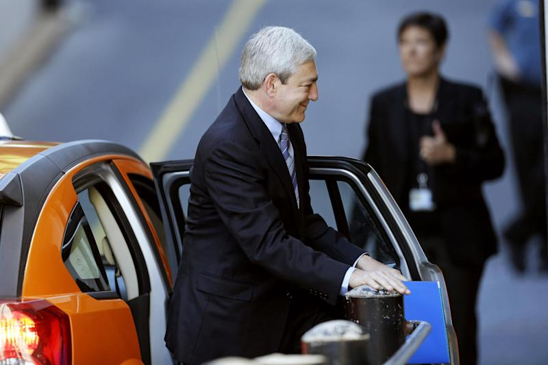 Former Penn State president Graham Spanier enters the Dauphin County Courthouse, Monday, July 29, 2013, in Harrisburg, Pa. Spanier, Gary Schultz and Timothy Curley are to go before a judge Monday to determine whether the three must face trial on charges they covered up an allegation that Jerry Sandusky was sexually preying on boys. (AP Photo/Matt Rourke)