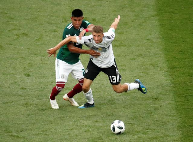 Soccer Football - World Cup - Group F - Germany vs Mexico - Luzhniki Stadium, Moscow, Russia - June 17, 2018 Germany's Thomas Muller in action with Mexico's Hugo Ayala REUTERS/Christian Hartmann