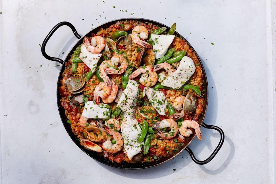 "If you're using a charcoal grill, you'll want to actively monitor the heat in different spots and shift the pan this way and that as needed. <a href=""https://www.bonappetit.com/recipe/grilled-seafood-paella?mbid=synd_yahoo_rss"" rel=""nofollow noopener"" target=""_blank"" data-ylk=""slk:See recipe."" class=""link rapid-noclick-resp"">See recipe.</a>"