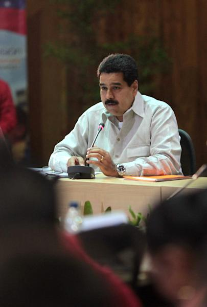 In this photo released by Miraflores Press Office, Venezuela's Vice President Nicolas Maduro speaks during a meeting with members of his cabinet in Caracas, Venezuela, Friday, Jan. 11, 2013. Maduro said he will travel to Cuba on Friday to visit ailing President Hugo Chavez and his family. Maduro announced his trip on television, saying he would also meet with Chavez's medical team. The government says the Venezuelan leader is fighting a severe respiratory infection a month after he underwent cancer surgery in Havana. (AP Photo/Miraflores Press Office)