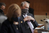 Sen. Tim Kaine, D-Va., listens to Surgeon General Jerome Adams give an opening statement during a Senate Health, Education, Labor and Pensions Committee hearing to discuss vaccines and protecting public health during the coronavirus pandemic on Capitol Hill, Wednesday, Sept. 9, 2020, in Washington. (Greg Nash/Pool via AP)