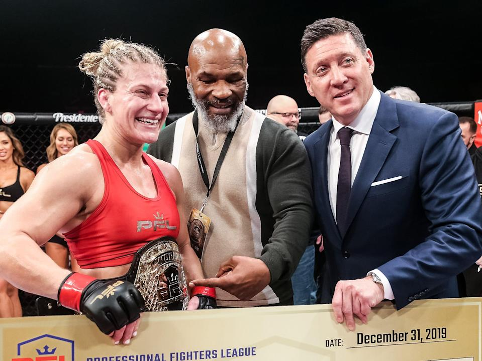 <p>Mike Tyson (centre) with PFL women's lightweight champion Kayla Harrison and CEO Peter Murray</p> (Ryan Loco)