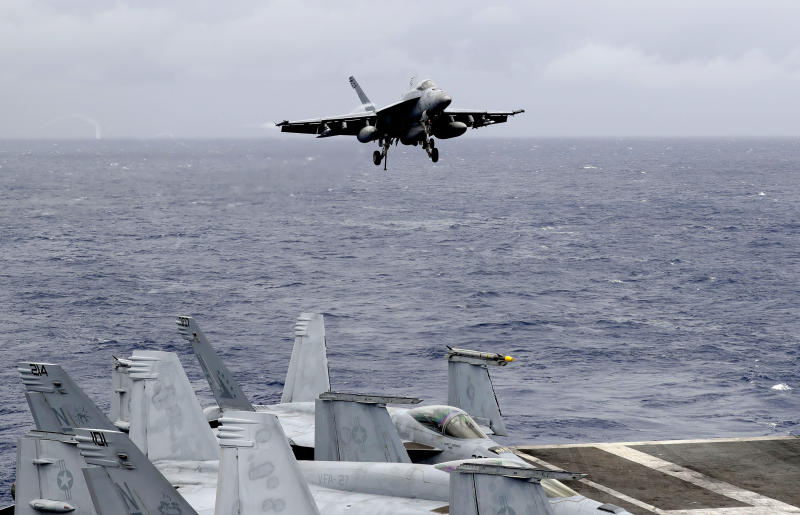 FILE - In this Aug. 6, 2019, file photo, a U.S. fighter jet prepares to land on the U.S. aircraft carrier USS Ronald Reagan following their patrol at the international waters off the South China Sea. The U.S. Air Force's chief of staff says there are no plans to reduce freedom of operations in the South China Sea that China points to as the source of increased tensions in the region. (AP Photo/Bullit Marquez, File)