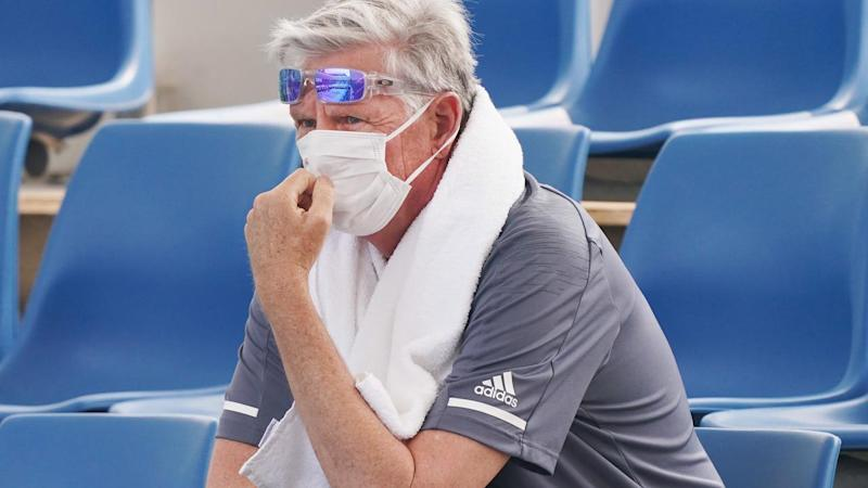 A spectator, pictured here wearing a face mask during Australian Open qualifying.