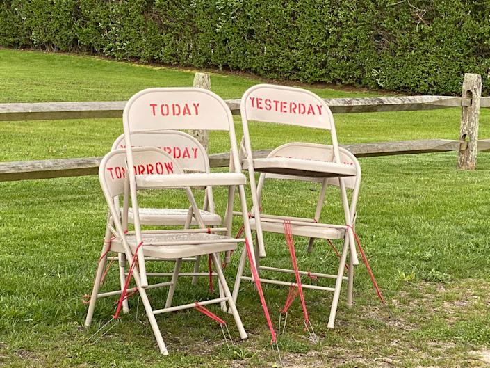 """In a """"Drive-by-Art"""" show in New York, Toni Ross and Sara Salaway exhibited When, a social-isolation """"calendar"""" of jumbled chairs with date-related words 