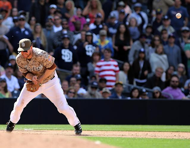 San Diego Padres third baseman Chase Headley makes a error on the hit by Detroit Tigers' Alex Gonzalez in the ninth inning of the baseball game on Sunday, April 13, 2014, in San Diego. The Padres won by a score of 5-1. (AP Photo/Don Boomer)