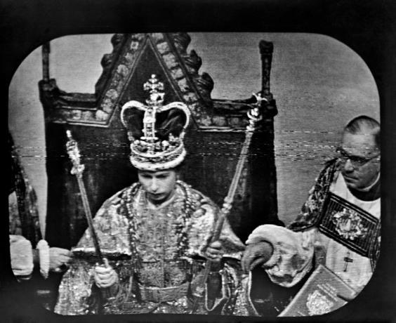 Queen Elizabeth II wears St Edward's Crown at the Coronation ceremony at Westminster Abbey. This was the view as seen by television viewers immediately after the Archbishop of Canterbury, Dr Geoffrey Fisher, placed the Crown upon the Queen's head (PA/PA Wire)