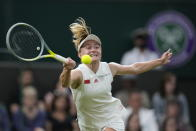 Aliaksandra Sasnovich of Belarus plays a return to Serena Williams of the US for the women's singles first round match on day two of the Wimbledon Tennis Championships in London, Tuesday June 29, 2021. (AP Photo/Kirsty Wigglesworth)