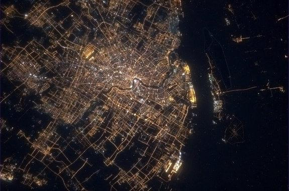 The dazzling lights of Shanghai, China, shine in this amazing view from the International Space Station by Canadian astronaut Chris Hadfield, who shared the image on Feb. 9, 2013, to mark Chinese New Year on Feb. 10.
