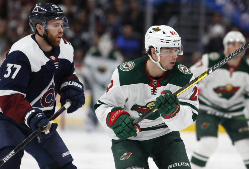 Minnesota Wild left wing Kevin Fiala, right, looks for a pass from a teammate as he drives past Colorado Avalanche left wing J.T. Compher, left, in the second period of an NHL hockey game Friday, Dec. 27, 2019, in Denver. (AP Photo/David Zalubowski)