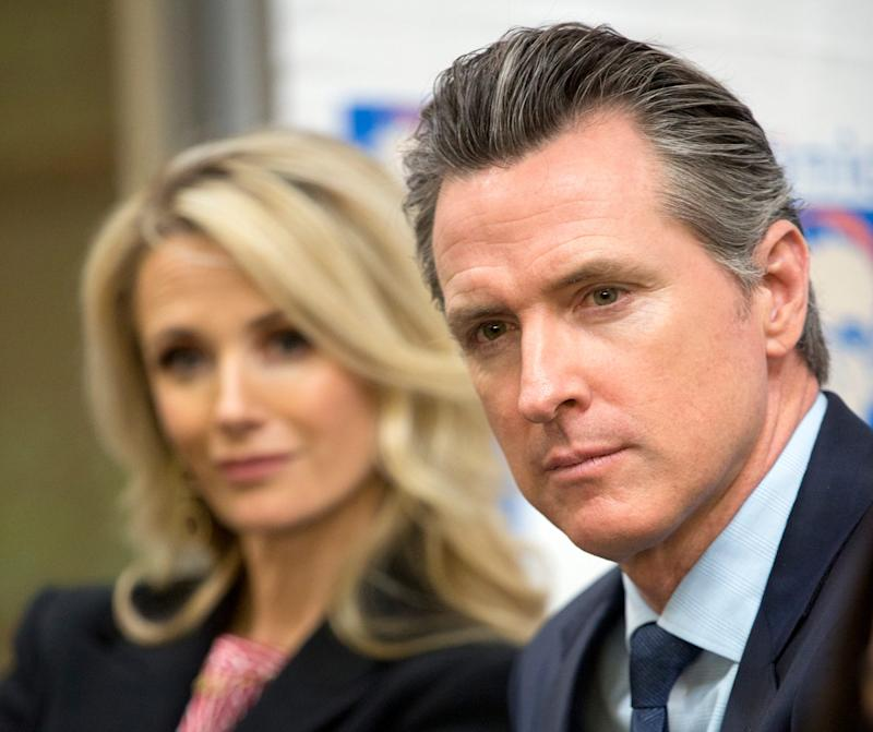 California Gov. Gavin Newsom, right, with his wife Jennifer Siebel Newsom listen during a roundtable discussion with Central American community leaders at the Clinica Monsenor Oscar Romero in Los Angeles on March 28. Newsom said he would be traveling to El Salvador in April to discuss the poverty and violence that's causing waves of migrants to seek asylum in the United States.