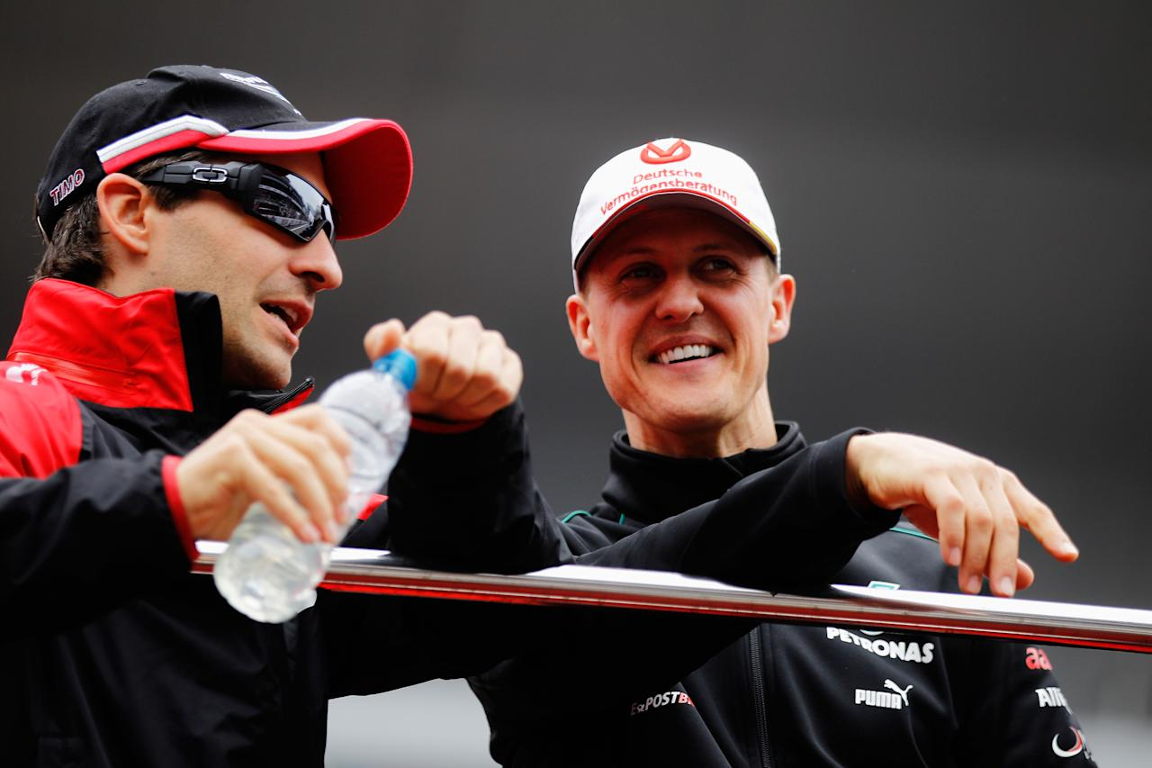 SHANGHAI, CHINA - APRIL 15:  (L-R) Timo Glock of Germany and Marussia talks with Michael Schumacher of Germany and Mercedes GP at the drivers parade before the Chinese Formula One Grand Prix at the Shanghai International Circuit on April 15, 2012 in Shanghai, China.  (Photo by Paul Gilham/Getty Images)