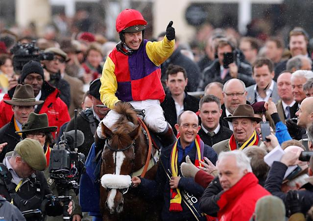 Horse Racing - Cheltenham Festival - Cheltenham Racecourse, Cheltenham, Britain - March 16, 2018 Richard Johnson on Native River celebrates winning the 15.30 Timico Cheltenham Gold Cup Chase REUTERS/Darren Staples