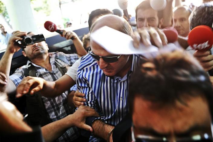 Members of the media gather around former head of the anti-terror department of the Istanbul police, Ali Fuat Yilmazer (C), detained as part of a criminal probe over alleged corruption, in Istanbul on July 22, 2014 (AFP Photo/Ozan Kose)