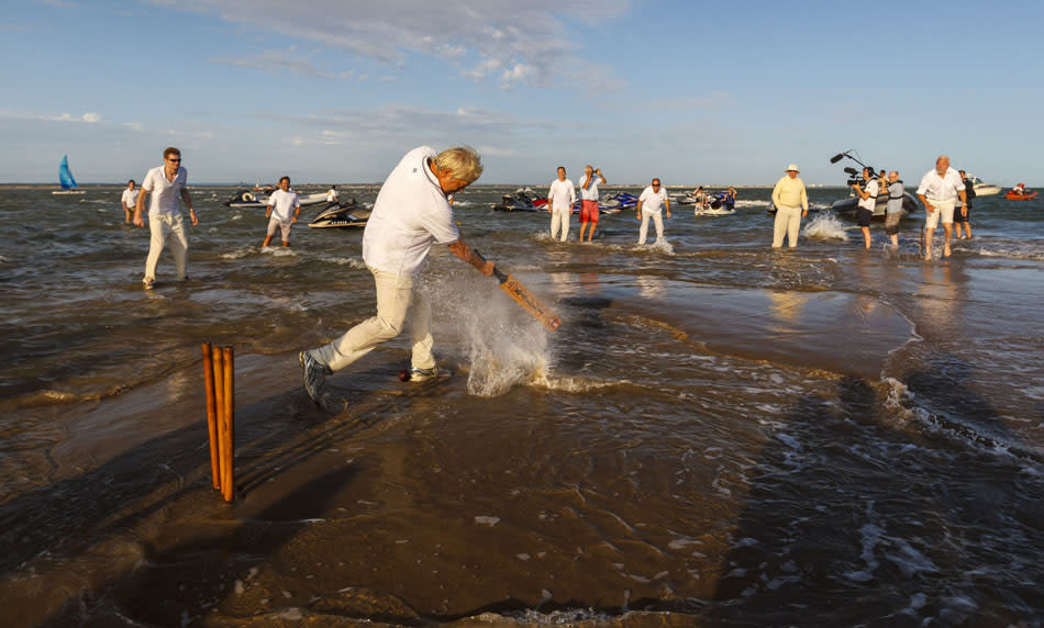 Action during the annual Bramble Bank cricket match which takes place on a sandbank in the middle of the Solent on the low spring tide.