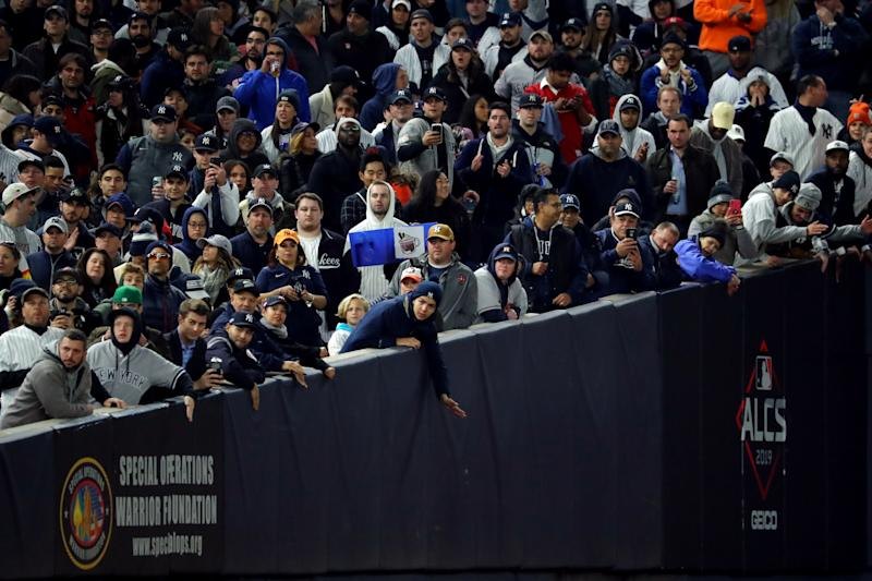 BRONX, NY - OCTOBER 18: Fans are seen cheering during Game 5 of the ALCS between the Houston Astros and the New York Yankees at Yankee Stadium on Friday, October 18, 2019 in the Bronx borough of New York City. (Photo by Alex Trautwig/MLB Photos via Getty Images)