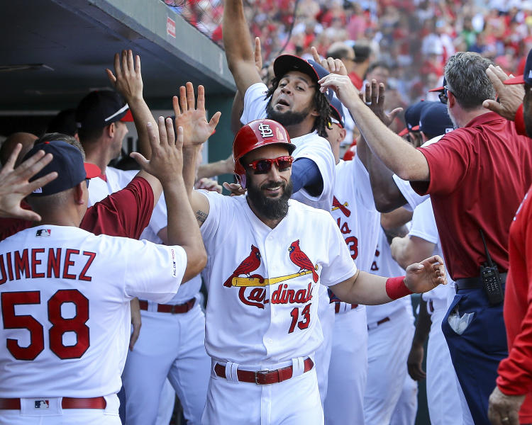 St. Louis Cardinals' Matt Carpenter, center, is congratulated by teammates after hitting a three-run home run during the third inning of a baseball game against the Chicago Cubs Sunday, Sept. 29, 2019, in St. Louis. (AP Photo/Scott Kane)
