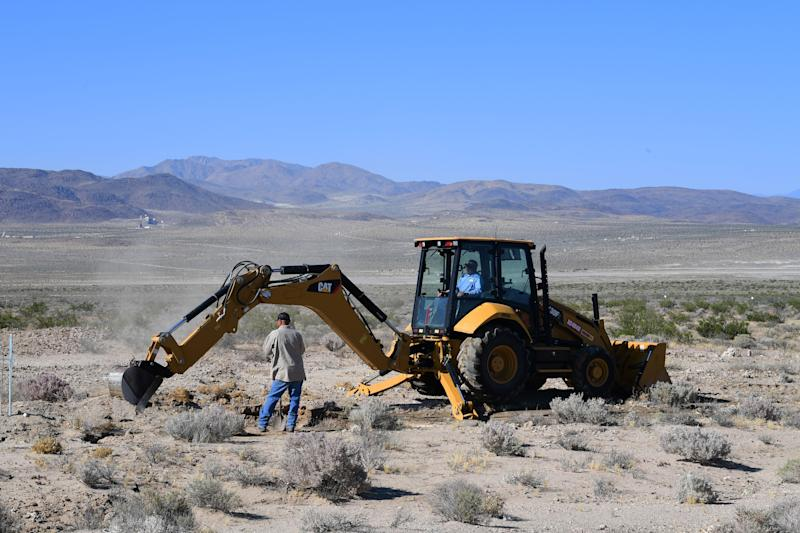 Construction workers fix a broken water line next to Highway 178, south of Trona, after a 6.4-magnitude earthquake hit in Ridgecrest, California, on July 4, 2019. - Southern California was rocked by a 6.4-magnitude earthquake Thursday morning, the US Geological Survey said, with authorities warning that the temblor, the largest in two decades, might not be the day's last. (Photo by FREDERIC J. BROWN / AFP) (Photo credit should read FREDERIC J. BROWN/AFP/Getty Images)