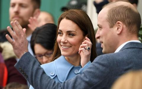The royal couple wave at well-wishers - Credit: Paul Ellis/AFP