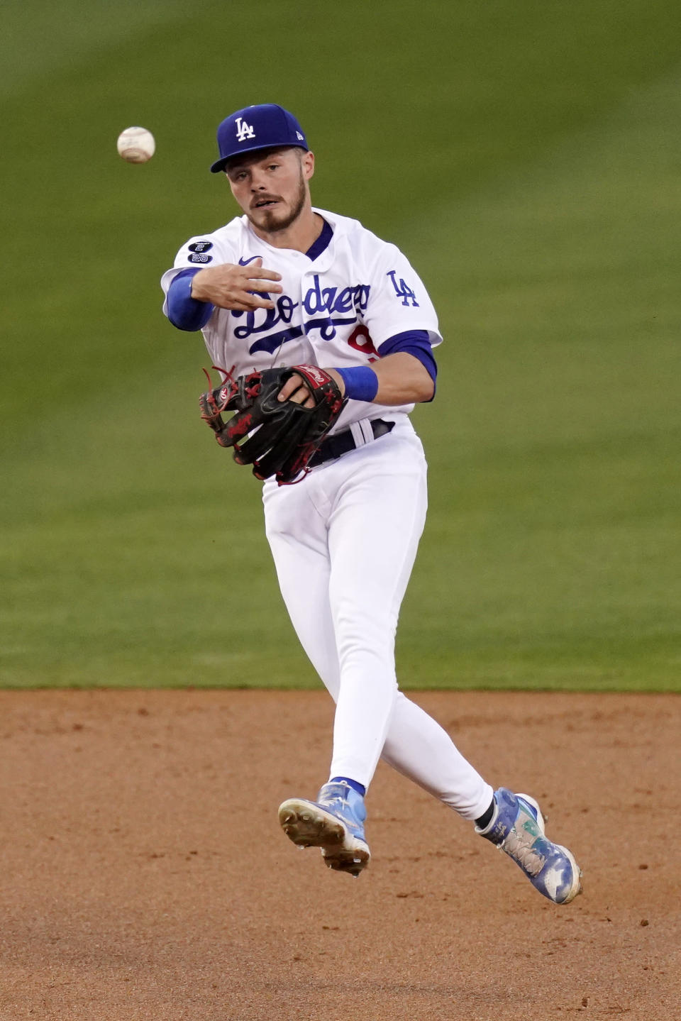 Los Angeles Dodgers second baseman Gavin Lux throws out Seattle Mariners' Dylan Moore at first during the second inning of an interleague baseball game Tuesday, May 11, 2021, in Los Angeles. (AP Photo/Mark J. Terrill)