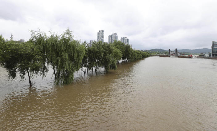 A part of a park near Han river is flooded after heavy rain in Seoul, South Korea, Sunday, Aug. 2, 2020. South Korean Meteorological Administration issued a warning of heavy rain for Seoul and central area. (Kim In-chul/Yonhap via AP)