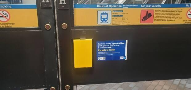The bright yellow square on this door called a germ-killing push-plate, is made up of compressed salt which ETS says is a safe surface to touch.