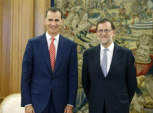 Spain king tasks acting PM Rajoy with forming new government