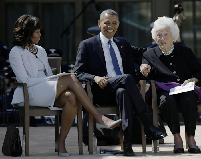 FILE - In this April 25, 2013 file photo, first lady Michelle Obama, left, and President Barack Obama, center, react as former first lady Barbara Bush gestures during the dedication of the George W. Bush Presidential Center in Dallas. By reaching beyond the pair of relatively safe issues she has pushed _ reducing childhood obesity and rallying public support for military families _ the Harvard-trained lawyer who some say has played it safe is showing a willingness to step outside of her comfort zone. (AP Photo/David J. Phillip, File)