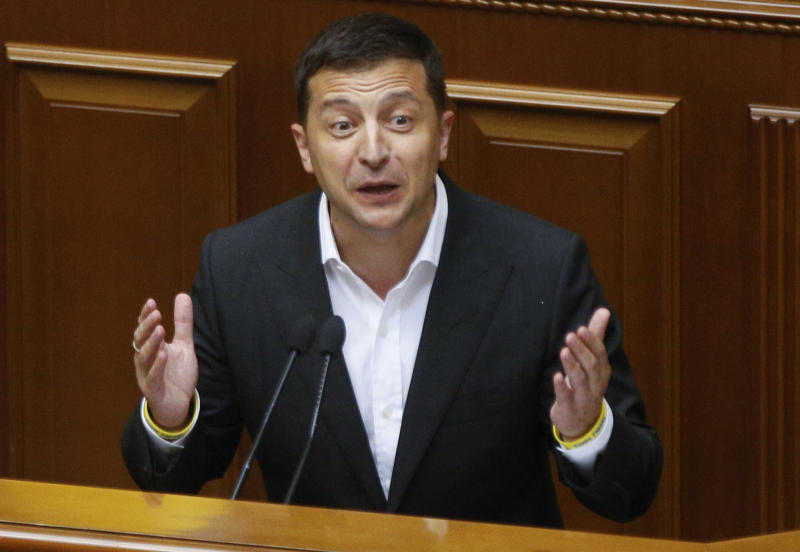FILE - In this file photo taken on Aug. 29, 2019, Ukrainian President Volodymyr Zelenskiy speaks to newly elected Ukrainian parliament deputies during parliament session in Kyiv, Ukraine. Zelenskiy, the comedian elected Ukraine's leader in April, took office pledging to focus on ending the deadly separatist fighting in the country's east, fomented by Russia. But now, barely 100 days in power, he finds himself at the center of a political furor involving the United States, Ukraine's friend and backer. (AP Photo/Efrem Lukatsky, File)