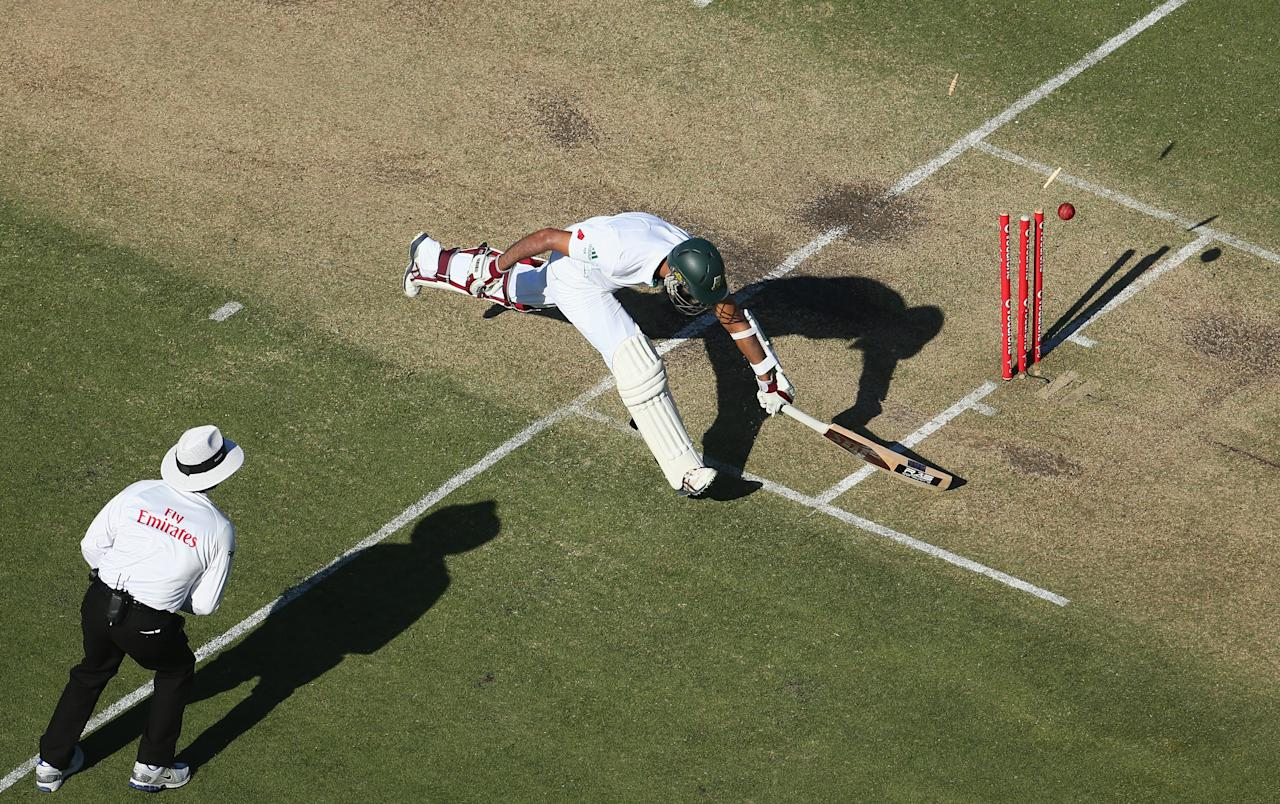 PERTH, AUSTRALIA - DECEMBER 01: Hashim Amla of South Africa survives a run out attempt during day two of the Third Test Match between Australia and South Africa at WACA on December 1, 2012 in Perth, Australia. (Photo by Robert Cianflone/Getty Images)