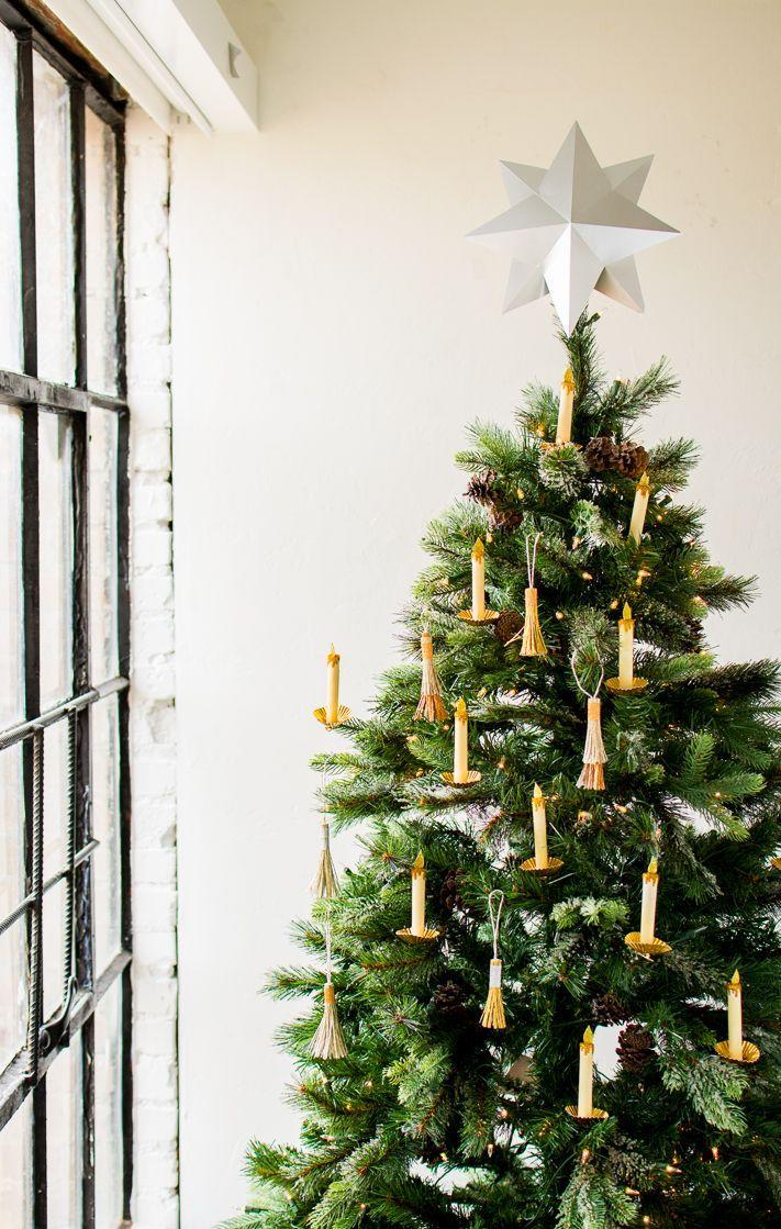 "<p>These paper candles are insanely chic and perfect if you're looking for a longer project to work on as opposed to buying clip on candle lights.</p><p>Get the tutorial at <a href=""http://thehousethatlarsbuilt.com/2017/11/paper-candle-christmas-tree-ornament.html/"" rel=""nofollow noopener"" target=""_blank"" data-ylk=""slk:The House That Lars Built"" class=""link rapid-noclick-resp"">The House That Lars Built</a>. </p>"