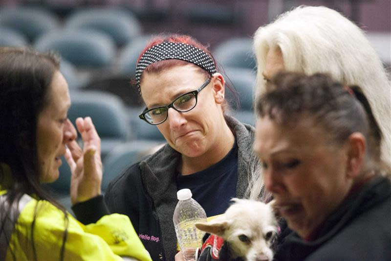 Union member Gabrielle Rogano reacts with fellow union members after hearing the resut of a union vote in Seattle