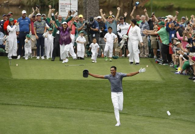Tony Finau reacts after hitting a hole in one on the seventh home during the par three competition at the Masters golf tournament Wednesday. (AP)