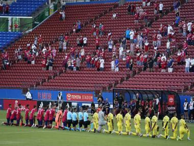Major League Soccer backs players booed for kneeling during pre-game national anthem