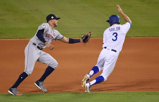 <p>Los Angeles Dodgers outfielder Chris Taylor (3) is tagged out by Houston Astros shortstop Carlos Correa (1) on a fielder's choice in the fourth inning in game two of the 2017 World Series at Dodger Stadium. Mandatory Credit: Jayne Kamin-Oncea-USA TODAY Sports </p>