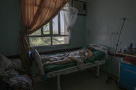 A Yemeni man, who is unidentified for his security, severely injured on June 5, 2021, after a ballistic missile and an explosive-laden drone fired by Yemen's Houthi rebels hit a fuel station in the Rawdha neighborhood, receives treatment at a hospital, in Marib, Yemen, Monday, June 21, 2021. (AP Photo/Nariman El-Mofty)