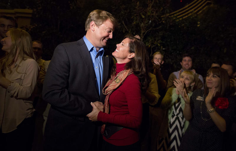 Sen. Dean Heller, left, shares a moment with his wife, Lynne, after speaking to the media about his win over challenger Rep. Shelley Berkley, in Las Vegas, Nov. 7, 2012. (Photo: Julie Jacobson/AP)
